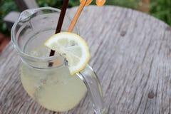 Lemon drink. On wood background Royalty Free Stock Photography