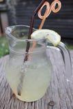 Lemon drink. On wood background Royalty Free Stock Photos