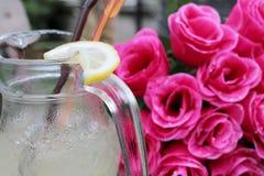 Lemon drink. On wood background Royalty Free Stock Images