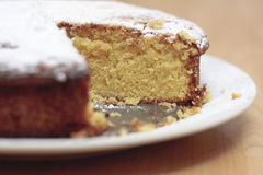 Lemon drizzle cake. A home baked lemon drizzle cake with a slice missing Royalty Free Stock Photography