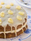 Lemon Drizzle Cake. On a blue floral patterned plate Stock Photography