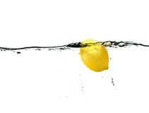 Lemon drop. Fast shutter speed capture as Lemon bobs back to the surface of crystal clear Water Royalty Free Stock Image