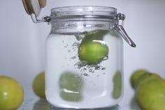 Lemon drop in bottle water. Royalty Free Stock Photo
