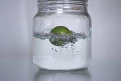Lemon drop in bottle water. Stock Images