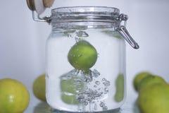 Lemon drop in bottle water. Stock Photos
