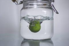 Lemon drop in bottle water. Royalty Free Stock Image