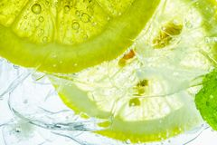Lemon drop in fizzy sparkling water, juice. Refreshment Royalty Free Stock Photos