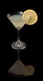 Lemon drop martini on black Stock Image