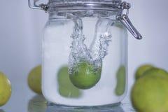 Lemon drop in water. Royalty Free Stock Photo