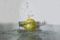 Lemon drop in water. Stock Photos