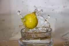 Lemon drop in water. Stock Photo