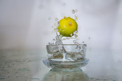 Lemon drop in water. Stock Photography