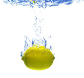 Lemon is dropped. A background of bubbles forming in blue water after lemon is dropped stock photos