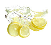 Lemon is dropped into water royalty free stock images