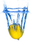 Lemon dropped in water Royalty Free Stock Photos