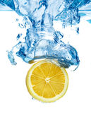 Lemon dropped in a water Stock Photography