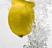 Lemon dropped into water Royalty Free Stock Photo