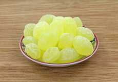 Lemon drops in dish Royalty Free Stock Photos