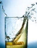 Lemon drops in a glass of drink Stock Photo