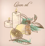 Lemon essential oil and candles Stock Photo