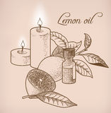 Lemon essential oil and candles Royalty Free Stock Photography