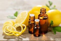 Lemon essential oil and lemon fruit Stock Photos