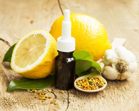 Lemon Essential Oil with Pollen and Garlic.Cold Treatment Royalty Free Stock Images