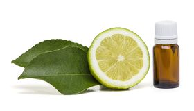 Lemon essential oil with two side leaves stock image
