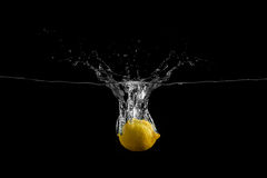 Lemon fall in the water Stock Photos