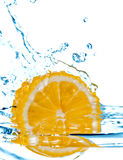 Lemon fall in water with splash. Photo of the lemon slice fall in water with splash isolated on white Stock Photography