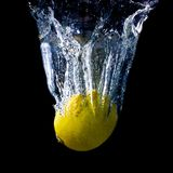 Lemon falling deeply under water Royalty Free Stock Photos