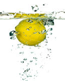 Lemon falling in water Stock Photos