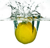 Lemon falling in water Royalty Free Stock Images