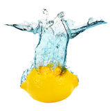 Lemon falling in water on the white background Stock Photos