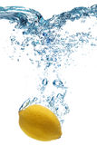 Lemon falls deeply under water Royalty Free Stock Photography