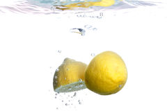Lemon falls into water Royalty Free Stock Photography