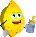 Lemon with feeding bottle Stock Images