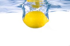 Lemon fell into the water. Close-up. Royalty Free Stock Image