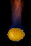 Lemon on fire Stock Photography