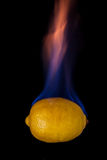 Lemon on fire Royalty Free Stock Photography