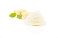 Lemon flavor ice cream with lemon slices in background Royalty Free Stock Images