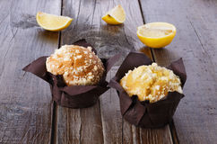 Lemon flavoured muffins on dark wooden background Royalty Free Stock Photo