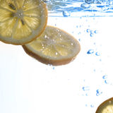 Lemon floating in water Royalty Free Stock Images