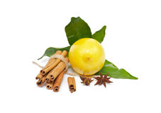 Lemon with foliage and spices. Lemon with foliage and cinnamon and anise Royalty Free Stock Photography