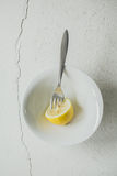 Lemon and a Fork Stock Image