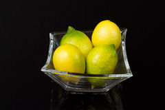 Lemon. Four lemons in a glass Bowl Royalty Free Stock Image