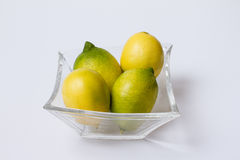 Lemon. Four lemons in a glass Bowl Stock Images