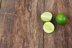 Lemon fresh green and slice lime on wooden Royalty Free Stock Photos
