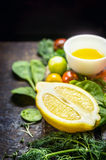 Lemon with fresh herbs, seasoning  and dressing, ingredients for cooking Stock Image