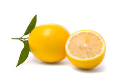 Lemon with fresh leaves Stock Photos